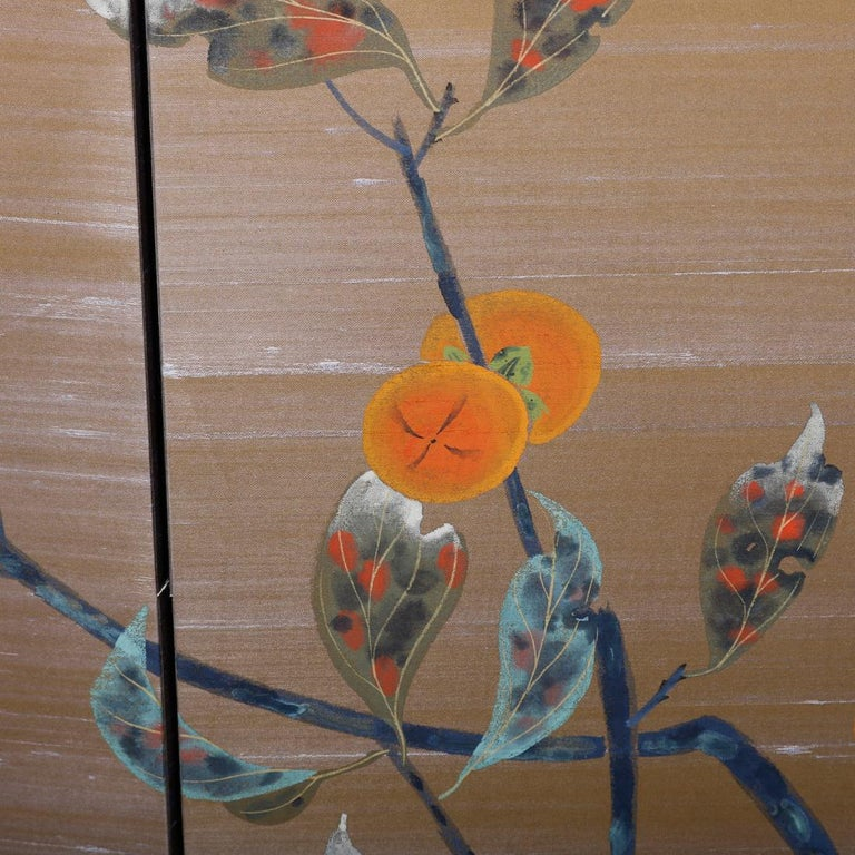 A vintage Japanese folding screen offers four panels with continuous hand painted tree branch with leaves, 20th century.  Measures: 36