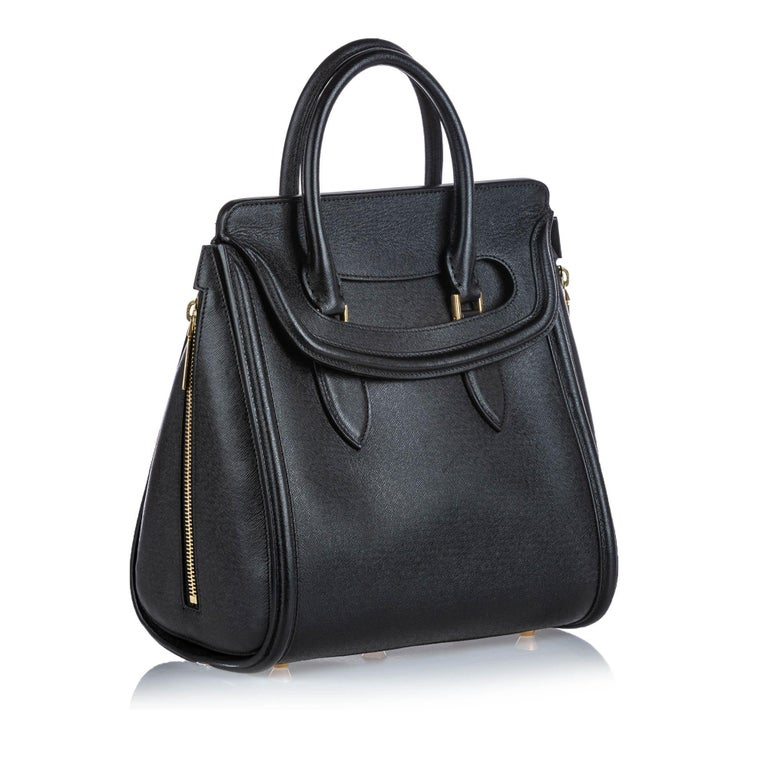 This Heroine satchel features a leather body, rolled leather handles, a top flap closure, and an interior zip pocket. It carries as AB condition rating.  Inclusions:  This item does not come with inclusions.  Dimensions: Length: 28.00 cm Width: