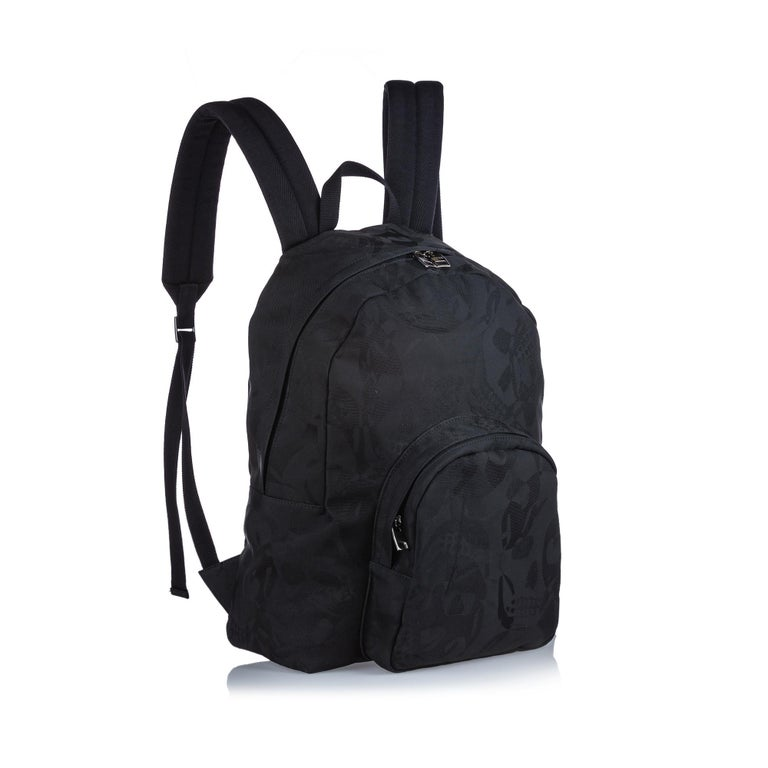 This backpack features a jacquard body, a flat top handle, flat back straps, a top zip closure, an exterior zip pocket, and an interior zip pocket. It carries as A condition rating.  Inclusions:  This item does not come with