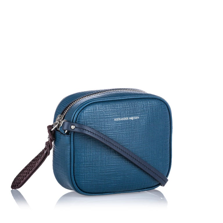 The Mini Camera Bag features a leather body, flat leather strap, a top zip closure, an exterior slip pocket and an interior slip pocket. It carries as AB condition rating.  Inclusions:  This item does not come with inclusions.  Dimensions: Length: