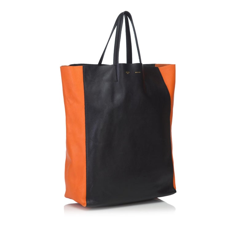 This Vertical Cabas features a leather body, flat leather handles, open top, and an interior zip pocket. It carries as AB condition rating.  Inclusions:  This item does not come with inclusions.  Dimensions: Length: 43.00 cm Width: 14.00 cm Depth: