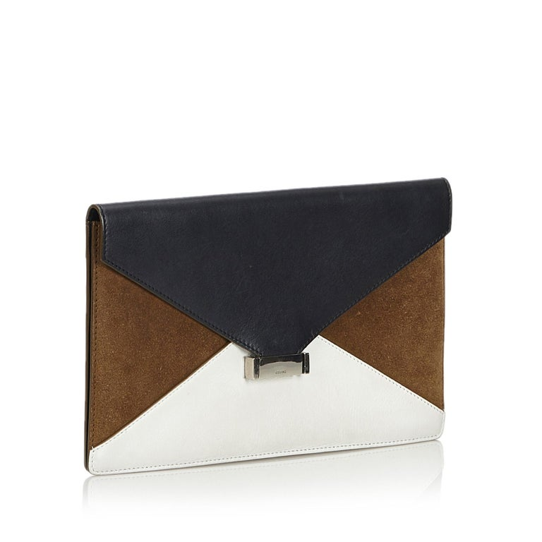 The Diamond Clutch features a leather and suede body, front flap with push lock closure, and an interior zip pocket. It carries as B+ condition rating.  Inclusions:  This item does not come with inclusions.  Dimensions: Length: 17.00 cm Width: 27.50
