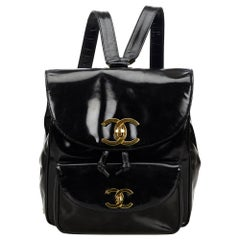 Vintage Authentic Chanel Black Patent Leather Drawstring Backpack France MEDIUM