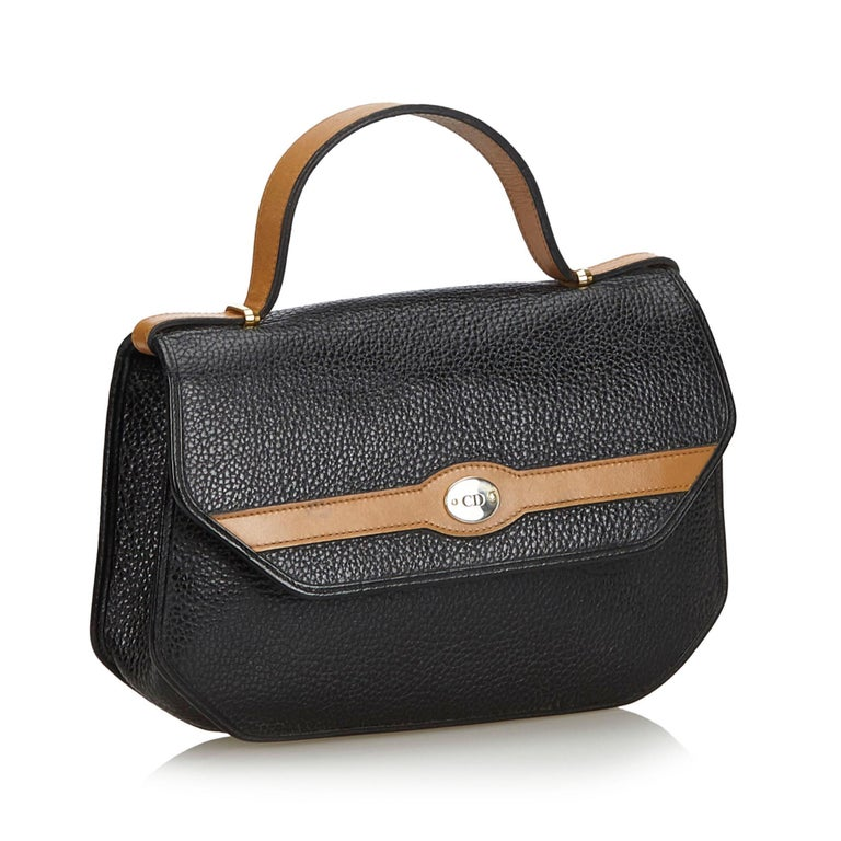 This handbag features a leather body, a flat leather handle, a top flap with snap button closure, and an interior zip pocket. It carries as B condition rating.  Inclusions:  This item does not come with inclusions.  Dimensions: Length: 17.00