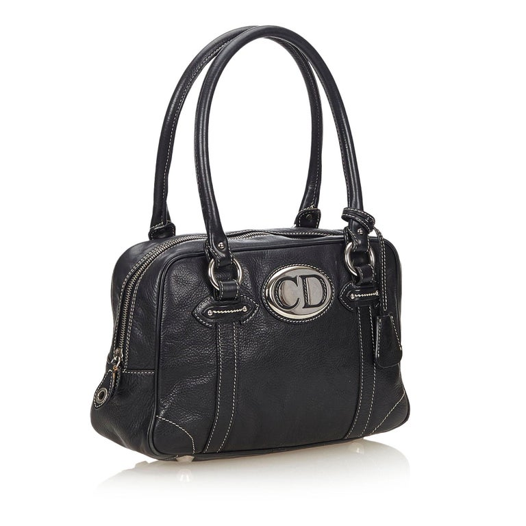 This handbag features a leather body, rolled leather straps, top zip closure, and interior zip pocket. It carries as B condition rating.  Inclusions:  Key Dimensions: Length: 35.00 cm Width: 20.00 cm Depth: 10.00 cm Hand Drop: 20.00 cm  Material: