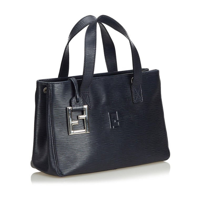 This handbag features a leather body, flat straps, open top and interior zip pocket. It carries as B+ condition rating.  Inclusions:  This item does not come with inclusions.  Dimensions: Length: 20.00 cm Width: 29.00 cm Depth: 10.00 cm Hand Drop: