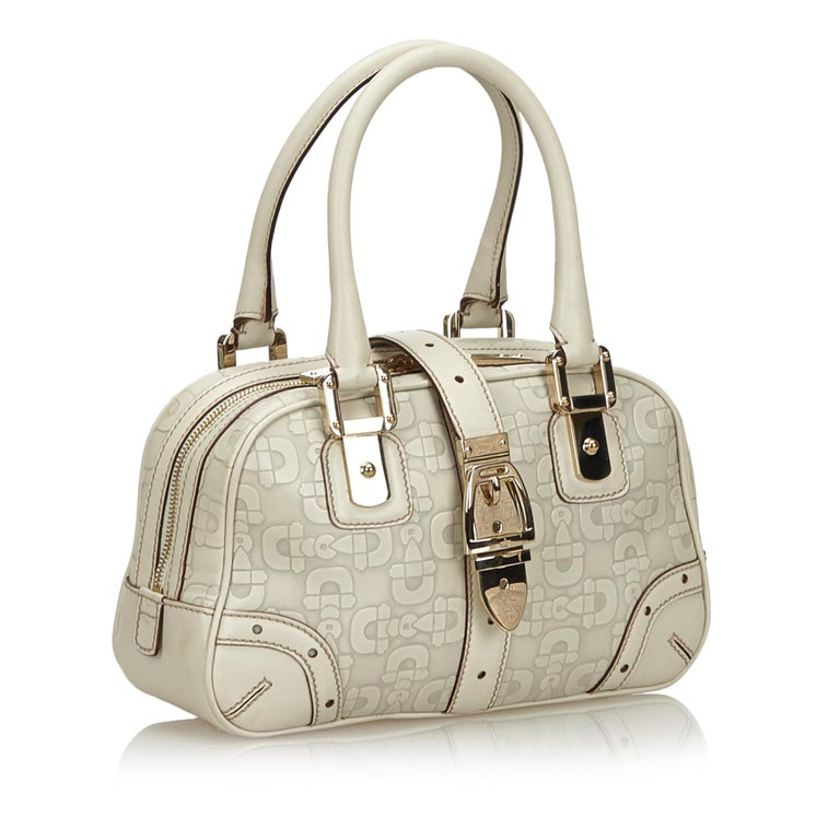 This handbag features a leather body, rolled leather handles, a top zip closure, a front strap with magnetic closure, and an interior zip pocket. It carries as B+ condition rating.  Inclusions:  Dust Bag  Dimensions: Length: 18.00 cm Width: 29.00