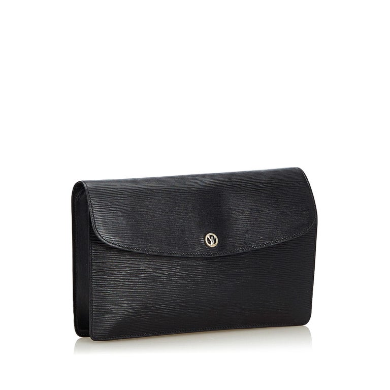 The Montaigne clutch features an epi leather body, a front flap with a magnetic closure, and an interior zip pocket. It carries as B+ condition rating.  Inclusions:  Dust Bag   Louis Vuitton pieces do not come with an authenticity card please refer