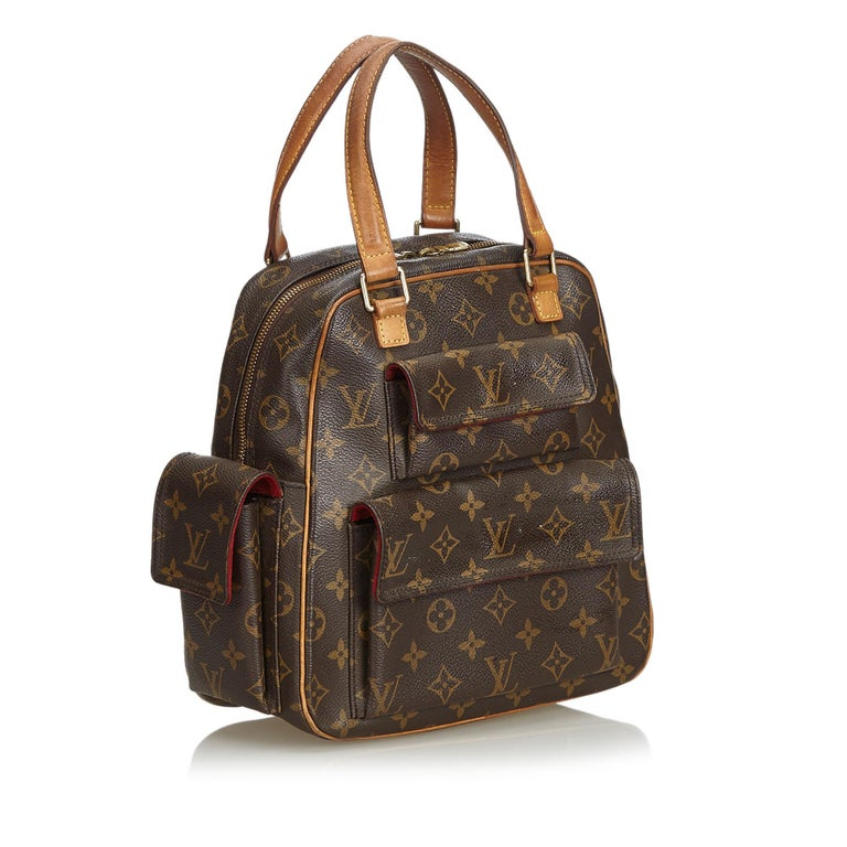 The Excentri-Cite features the Monogram canvas, flat vachetta straps and trim, exterior flap pockets, a two-way top zip closure, and interior pockets. It carries as B condition rating.  Inclusions:  Dust Bag  Louis Vuitton pieces do not come with an