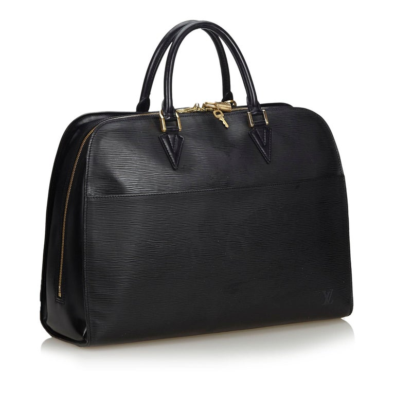 The Sorbonne features an epi leather body, rolled leather handles, a top zip closure, and zip and slip pockets. It carries as B condition rating.  Inclusions:  Dust Bag Padlock Key   Louis Vuitton pieces do not come with an authenticity card please