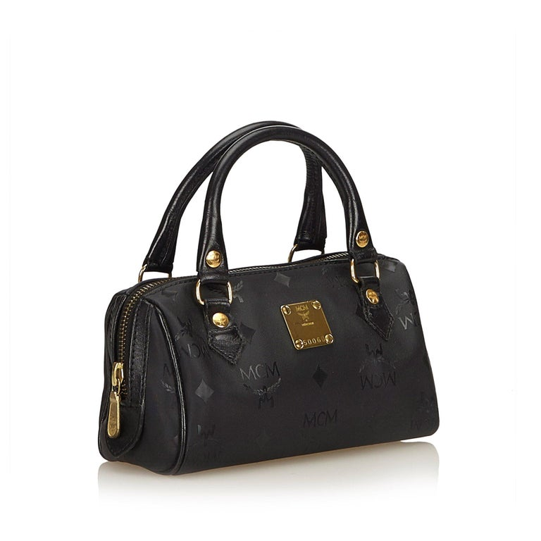 This boston bag features a pvc body, detachable shoulder strap, rolled leather handles, and a top zip closure. It carries as B+ condition rating.  Inclusions:  This item does not come with inclusions.  Dimensions: Length: 11.00 cm Width: 18.50