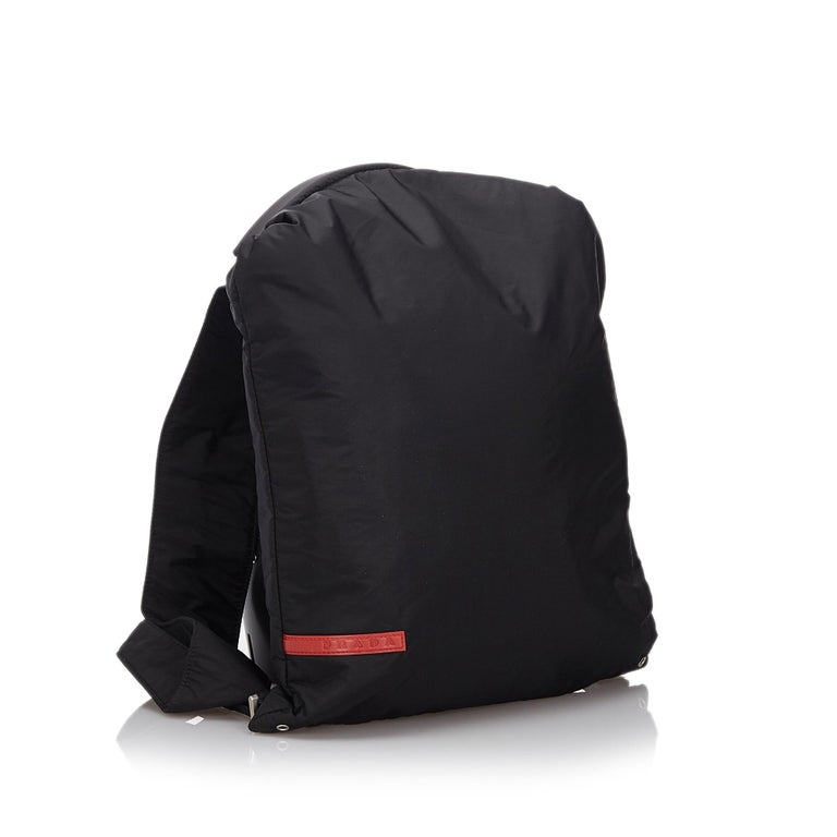 This backpack features a nylon body, flat back straps, and an open top with a metal buckle closure. It carries as AB condition rating.  Inclusions:  This item does not come with inclusions.  Dimensions: Length: 39.00 cm Width: 29.00 cm Depth: 1.00