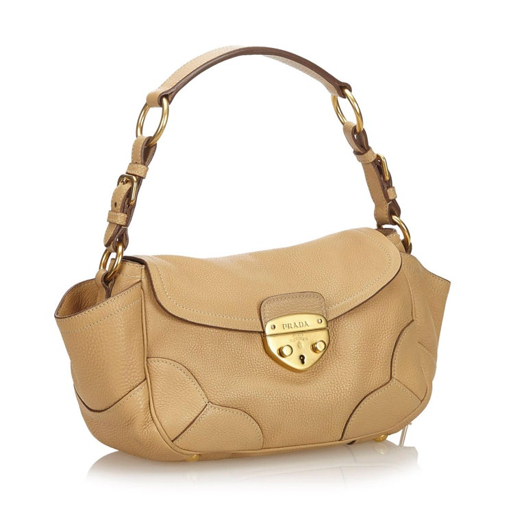 This baguette features a leather body, a flat leather handle, front flap with a push lock closure, and interior zip and slip pockets. It carries as AB condition rating.  Inclusions:  Dust Bag Key  Dimensions: Length: 16.00 cm Width: 39.00 cm Depth: