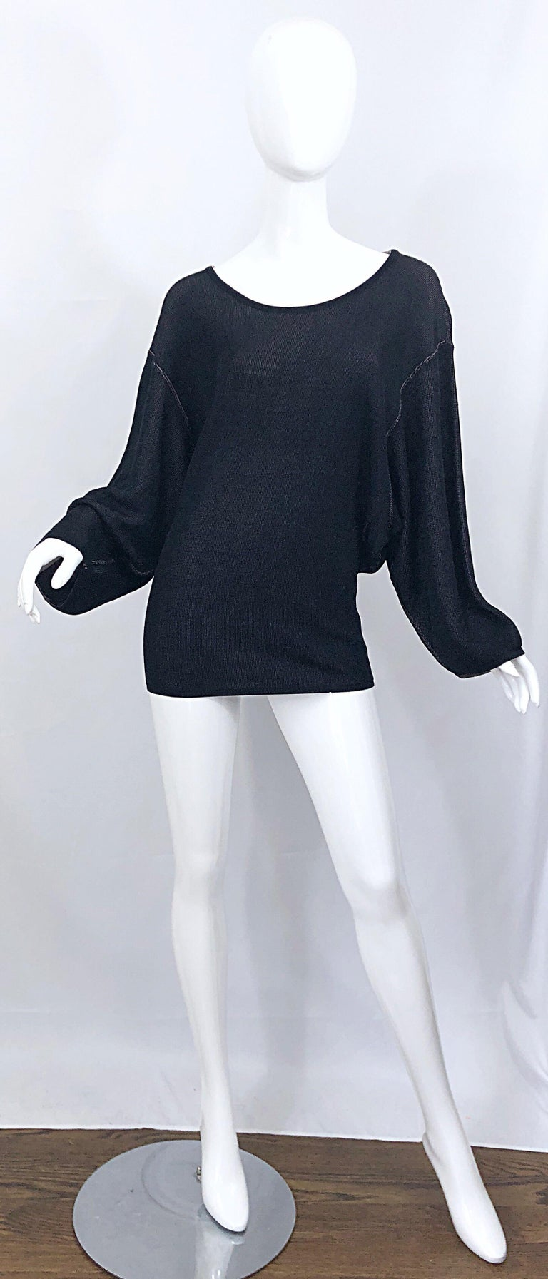 Sexy vintage 1980s AZZEDINE ALAIA black and nude viscose micro mini sweater dress / tunic! Features the most luxurious soft viscose rayon that drapes the body so beautifully. Dolman sleeves will accomodate an array of bust sizes, and skirt is meant