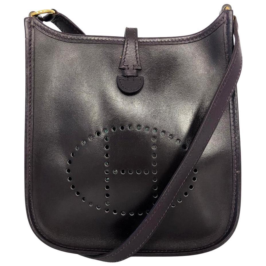 Vintage Bag  Hermès Evelyne TPM in Amarante colored leather
