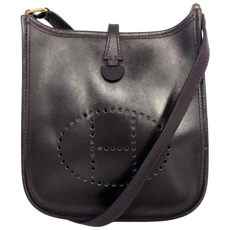 Vintage Bag  Hermès Evelyne TPM in Amarante colored leather For Sale