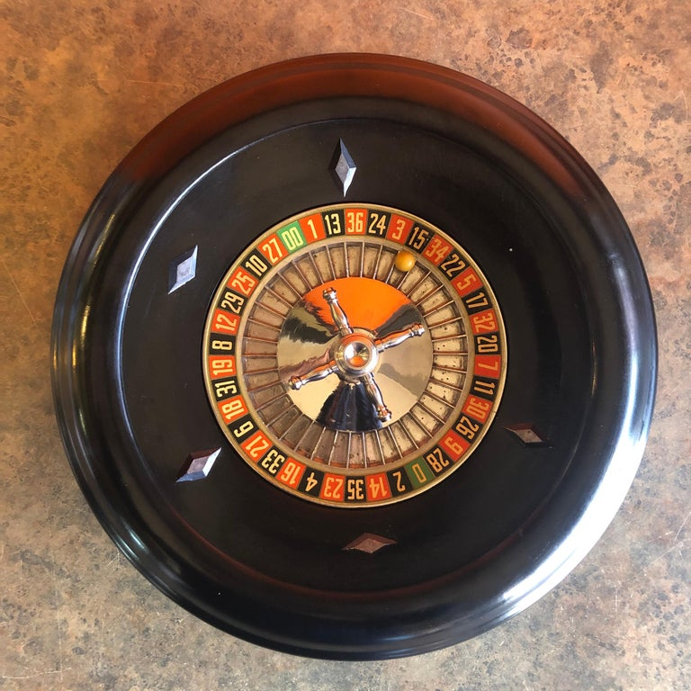 Vintage bakelite roulette wheel by Rottgames, circa 1940s. The wheel is 12