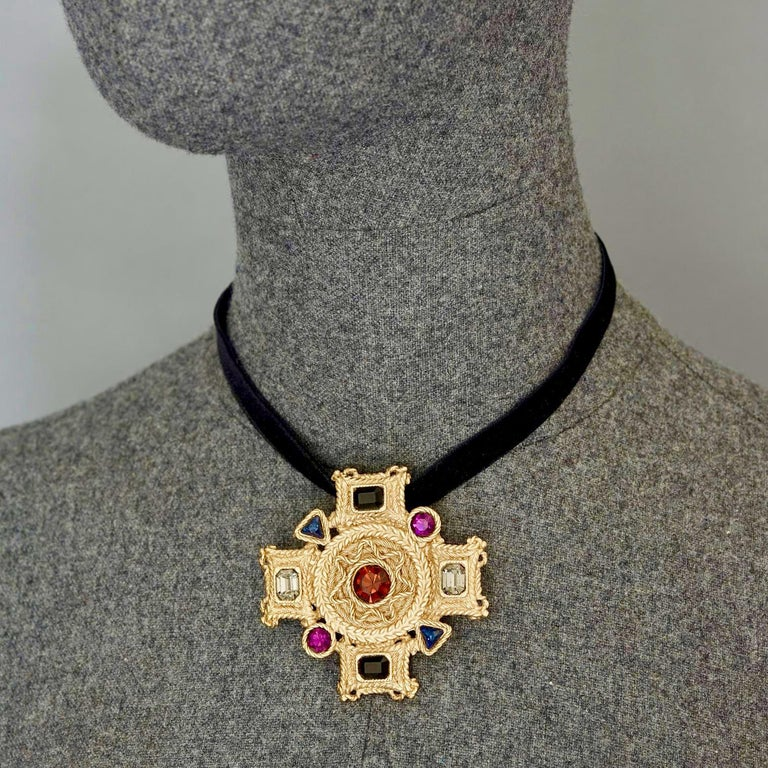 Vintage BALENCIAGA Byzantine Jewelled Cross Pendant Brooch  Measurements: Height: 2.48 inches (6.3 cm) Width: 2.48 inches (6.3 cm)  Features: - 100% Authentic BALENCIAGA. - Textured Byzantine cross with coloured rhinestones. - Gold tone. - Brooch