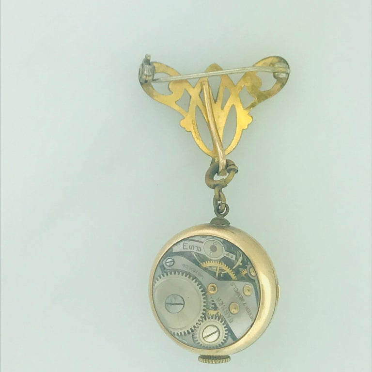 A vintage pin and clock/watch that is detachable and attachable. This piece is vintage and in great condition. The watch/clock is a Swiss made Banner watch with a skeleton back and 7-jewel powered. On the watch there is an easy to use spring ring