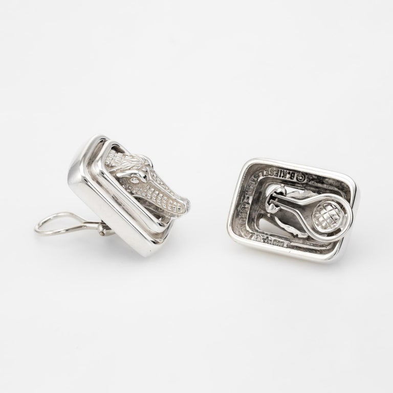 Finely detailed pair of Barry Kieselstein Cord alligator earrings, crafted in sterling silver.   The retired earrings are circa 1997 with the alligators featuring lifelike detail framed by a double square setting. The earrings are fitted with clip