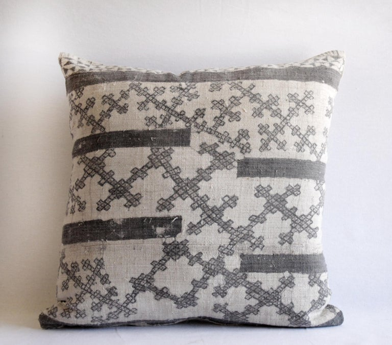 Vintage batik accent pillow charcoal and natural linen This is a beautiful vintage textile piece we have created into a pillow. The front side is a linen weave, light natural color background with a darker charcoal grey (faded black) batik pattern.