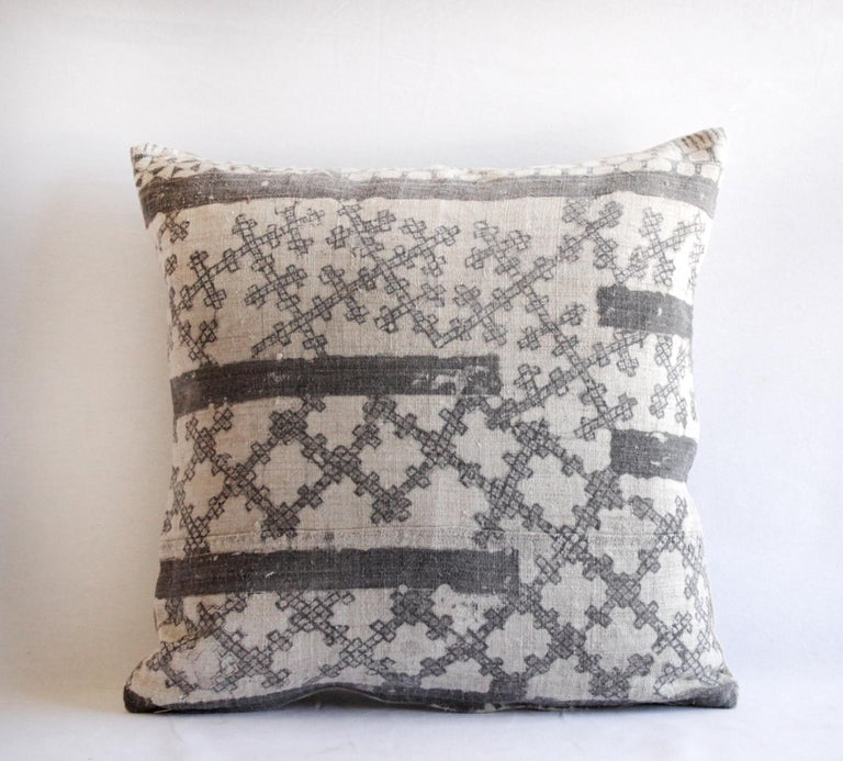 Vintage batik accent pillow charcoal and natural linen This is a beautiful vintage textile piece we have created into a pillow. The front side is a linen weave, light natural color background with a darker charcoal grey (faded black) batik