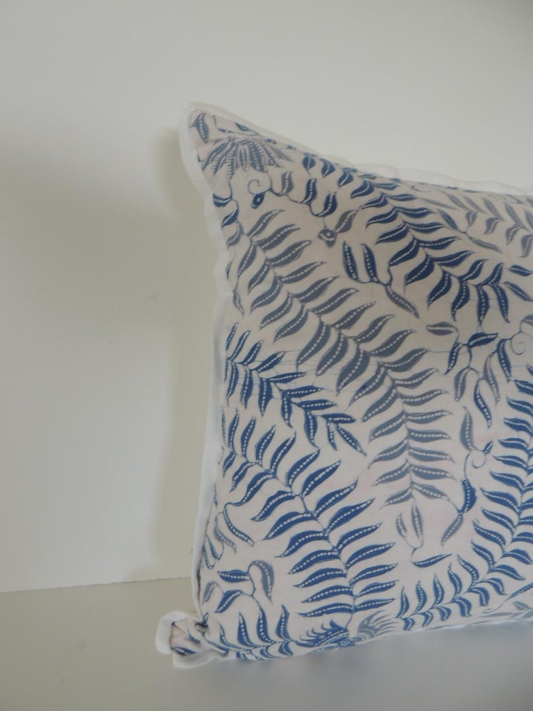 Petite square floral blue and white throw pillow depicting birds and fern in the front textile. Throw pillow in light and dark shades of blue. Pillow embellished with ATG custom white cotton flat trim all around. Decorative bolster pillow finished