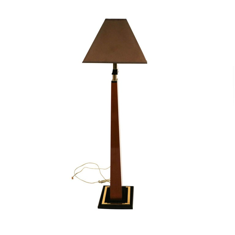 This is absolutely an extraordinary floor lamp by Bauer Lamp Company in an Empire Revival style, superior craftsmanship. Features a tall narrow wooden stem tapering to the top, with three short brass tubes supporting an electric fitting, raised on a