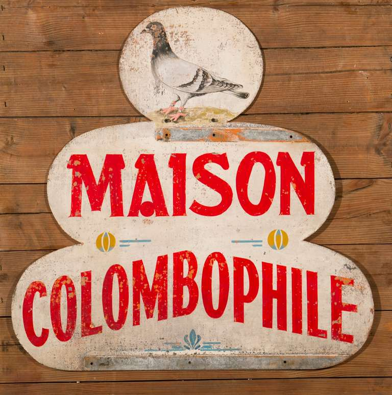 Vintage two-sided painted metal sign from Belgium. Would have been displayed by a Belgian carrier pigeon association. These associations would host pigeon races and other pigeon related activities.