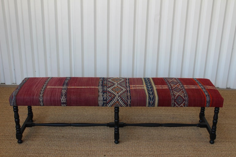 Vintage bench newly upholstered in a vintage flat-weave Kilim rug from Turkey. In excellent condition with new satin black finish on the walnut frame.