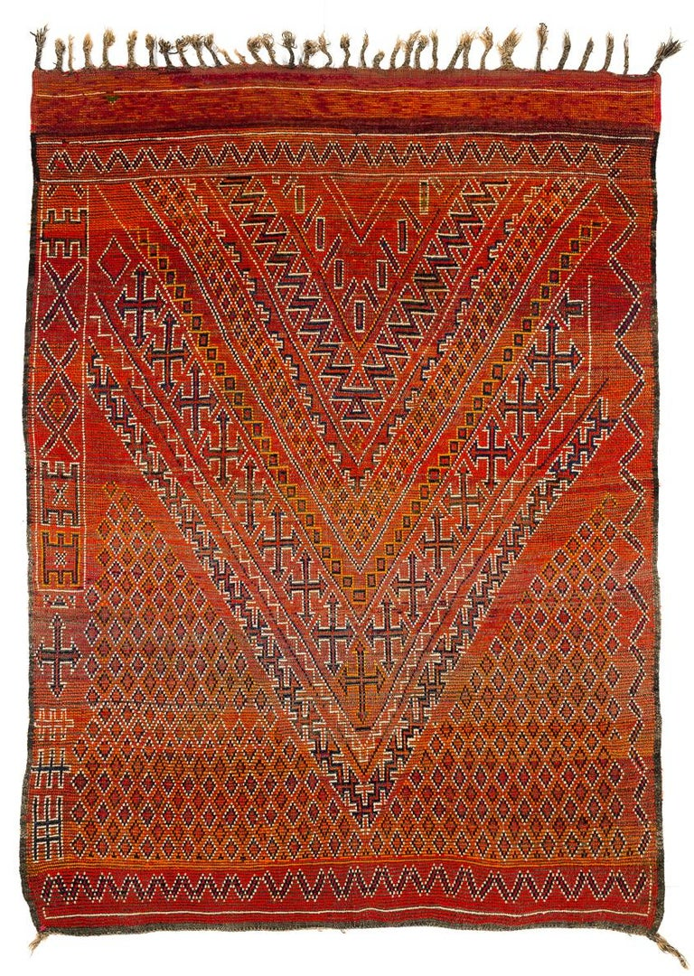 This vintage Moroccan rug is in perfect condition. It is woven with excellent and very lustrous wool in fiery reds and oranges and has an even and quite elegant surface. Another great classical Beni Mguild with real age and patina.