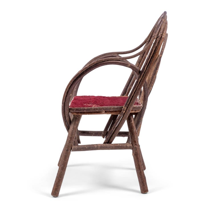 Vintage petite bent-willow chair, circa 1910s-1930s. Small Folk Art chair made from bent willow featuring original red velvet upholstered seat (seat can be reupholstered for a nominal cost). Perfect size for a small child, large doll or as a