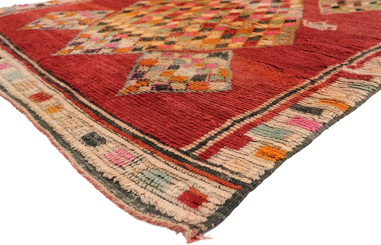 20898, vintage Berber Moroccan rug. This hand knotted wool vintage Berber Moroccan Boujad rug is heavy ornamented with diamonds dotted with two tea pots and two spiked lozenges in an abrashed red field. The tribal symbols of diamonds present in the