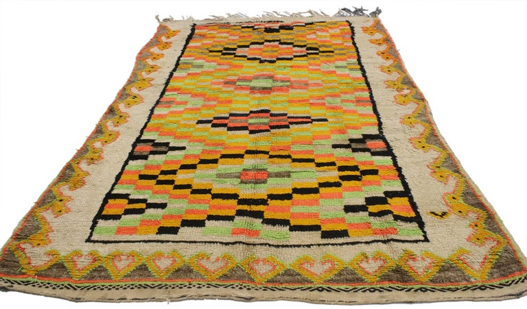 20574, vintage Berber Moroccan rug. This Vintage Berber Moroccan rug incorporates black, neon green, yellow, neon orange and taupe to provide a variegated yet harmonious design pattern that is woven into the center of the piece. The primary ornament