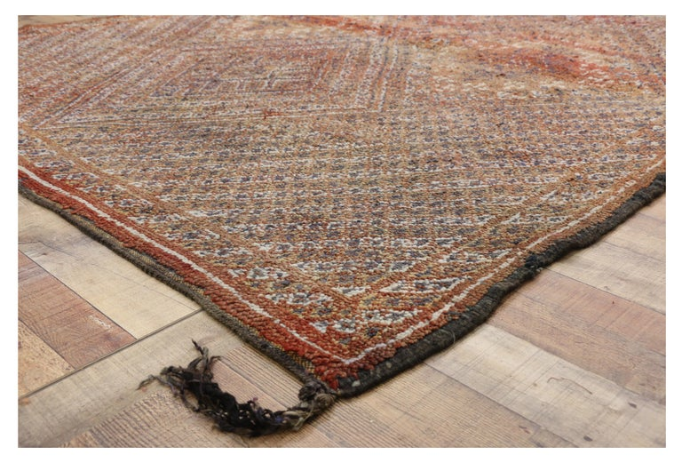 20597, vintage Berber Moroccan rug with tribal style. This vintage Berber Moroccan rug is marked with intricate detail above all else. The rich waves of abrash and primary colors composing the background consist of reddish-orange and beige, but upon