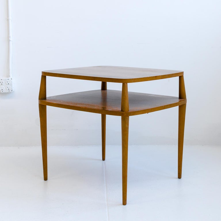 Elegant walnut side table designed by Bertha Schaefer and manufactured by Singer & Sons. This rare table has clean simple forms with sculptural patinated walnut. The table is in its original vintage unrestored condition with a Singer & Son's