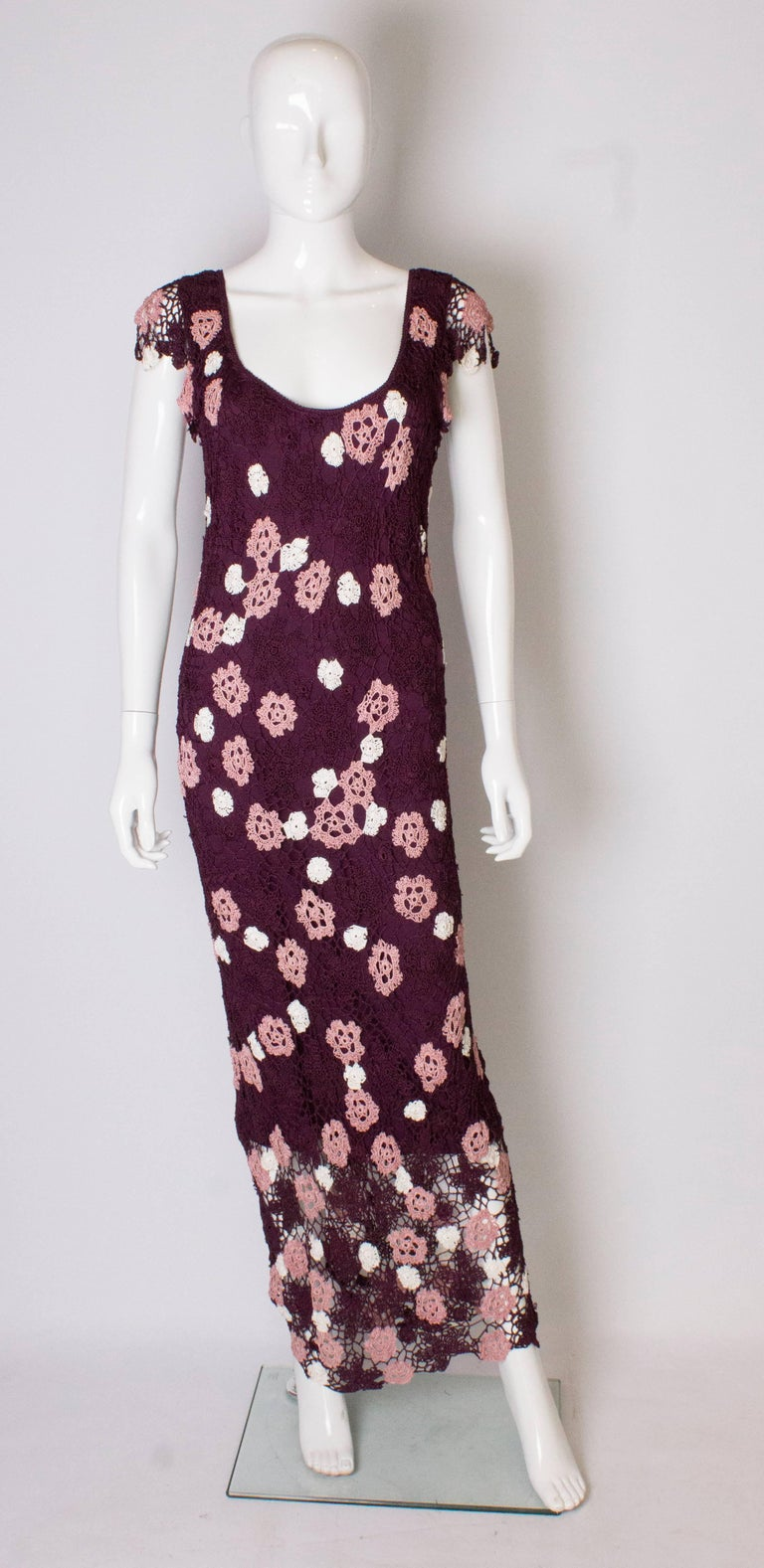 An easy to wear vintage crochet dress, that can be dressed up or down. The dress has a scoop neck , back and front, with cap like sleeves. It is a mixture of burgundy, cream and pink, and is fully lined.