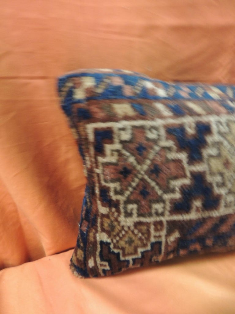 Vintage Bidjar rug fragment decorative lumbar pillow Vintage Bidjar rug fragment decorative lumbar pillow, traditional Turkish pattern with black cotton velvet backing and zipper closure. Decorative bolster pillow in shades of blue, red, brown,
