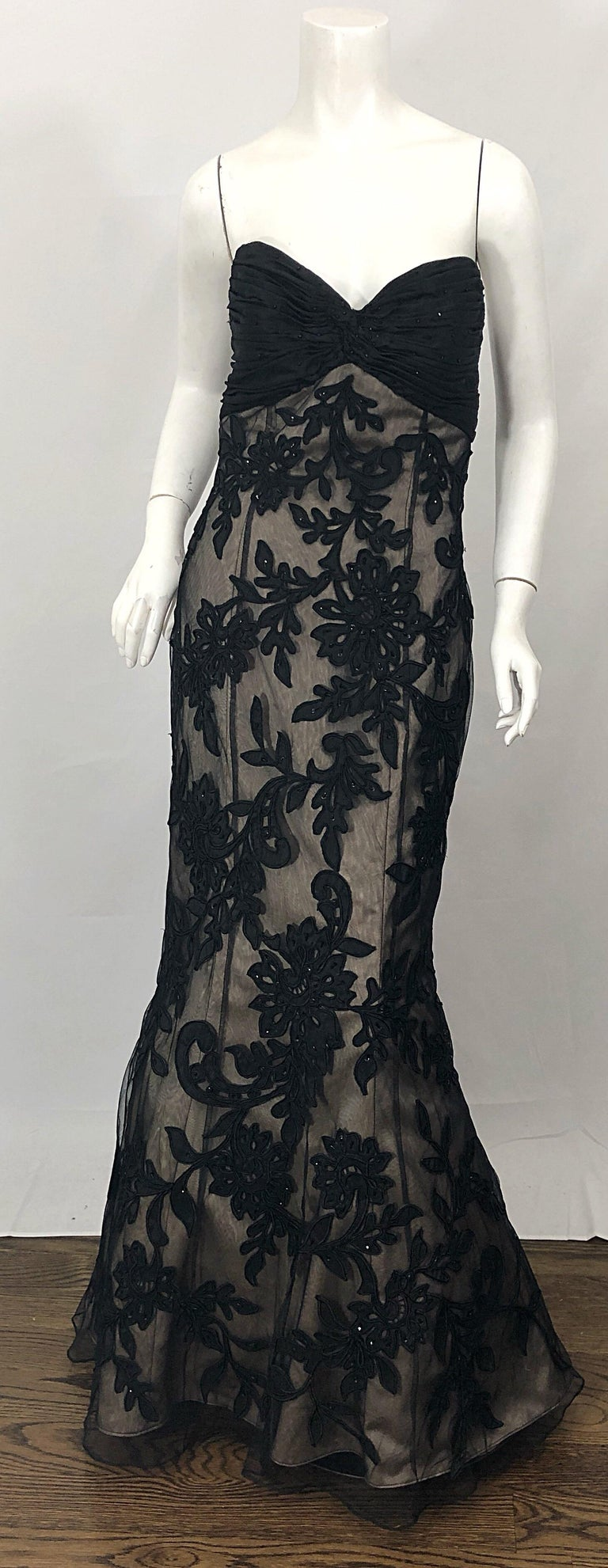 Sensational vintage BILL BLASS for SAKS 5th AVENUE black and nude silk beaded strapless mermaid gown! Features a bones ruched silk taffeta bodice. Black sheer embroidered and beaded silk lace overlay with nude silk underneath. Timeless flattering