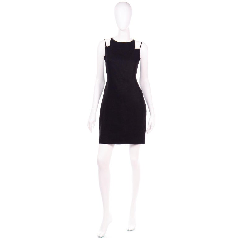 Vintage Bill Blass pieces are truly remarkable and we always grab them whenever we can! This amazing Bill Blass vintage black linen evening mini dress has a dramatic cutout design at the neck and shoulders that makes it so unique! We also love the