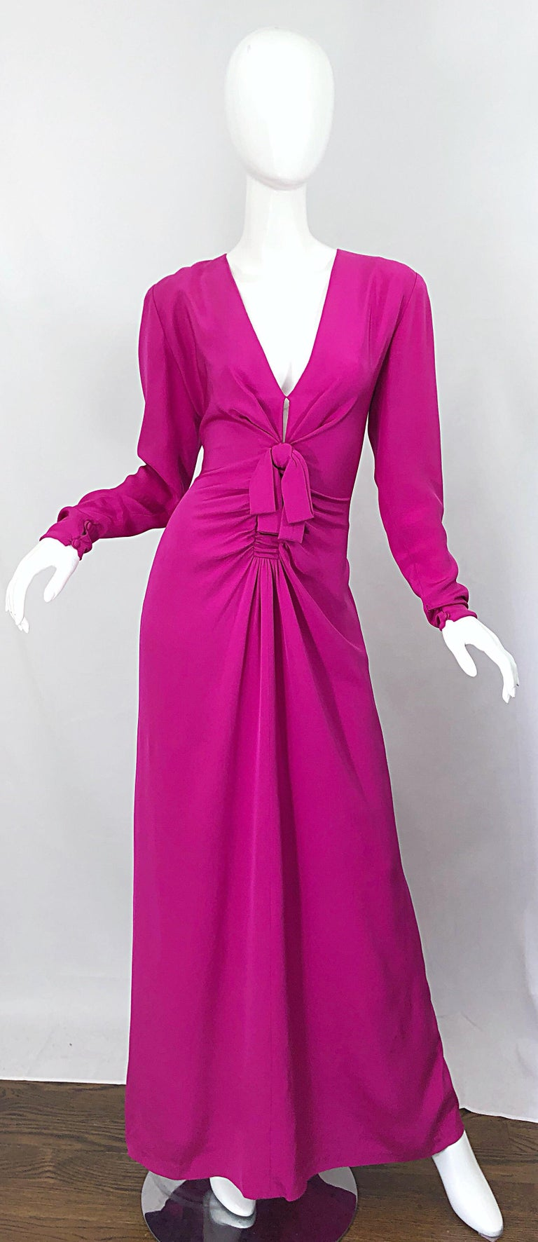 Stunning early 1980s BILL BLASS for NEIMAN MARCUS Couture quality hot pink / magenta fuchsia long sleeve silk jersey cut-out evening gown! Features a fitted bodice with flattering ruched detail at the waist. Cut-out at center bust reveals just the