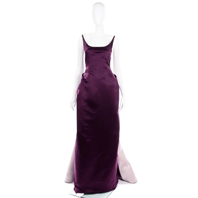 This vintage Bill Blass evening dress is so unique and a total showstopper! This deep purple satin dress has a thick tightly woven tulle under layer to add more fullness and structure to the skirt portion. The dress has a center panel on the back