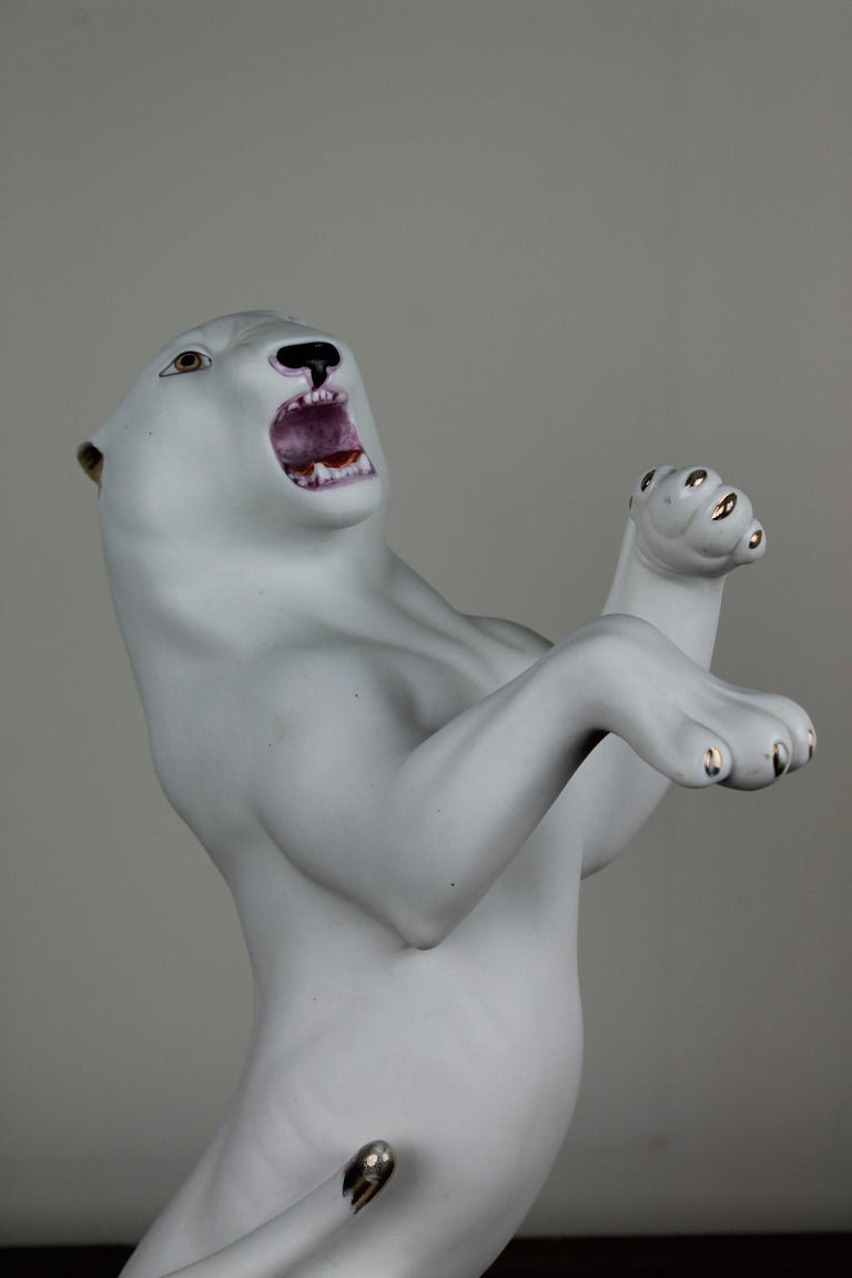 Vintage Hollywood Regency biscuit / porcelain statue of a large imminent white Puma with lots of Expression. Nice details with gold hand-painted accents on his claws and tale.   This awesome and luxurious Puma Figurine-statue is a collectable