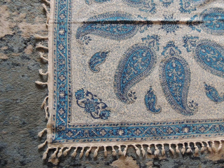Vintage red and blue paisley hand-blocked cloth with hand-knotted fringes Kalamkari or qalamkari is a type of hand painted or block-printed cotton textile,  produced in Iran and India. Its name originates in the Persian language which is  derived