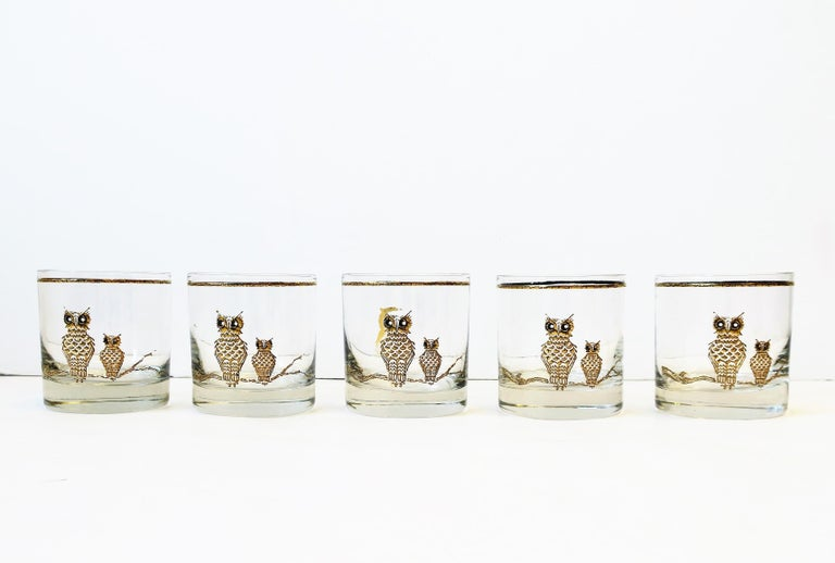 A beautiful set of five (5) black and gold cocktail rocks' glasses with a raised relief owl bird design (two owl birds perched on tree branch), circa 1960s. A great set for any bar, bar cart, entertainment area, etc. Dimensions: 3.13