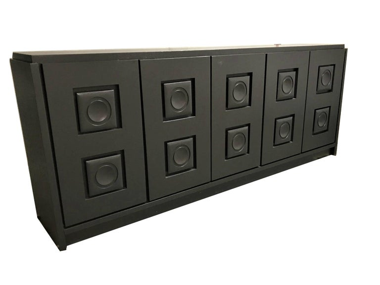 """Vintage black brutalist credenza with 5 doors and two inner drawers.  Heavy quality, very good condition, no damages.  Belgium, 1970s.  Dimensions: Length 273cm/107"""" Height 110cm/43"""" Depth 55/21.5"""".  Ref.: brtlsblck1."""