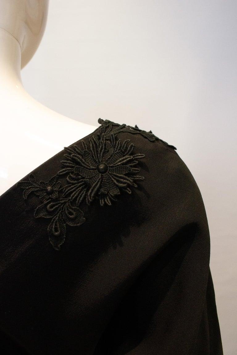 Vintage Black Cocktail Dress with Floral Applique. For Sale 1