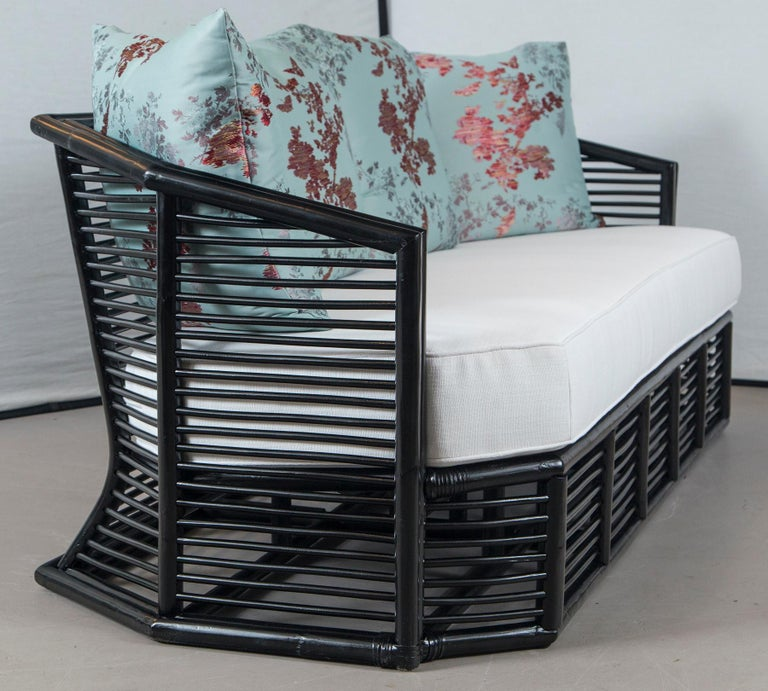 Modern Vintage Black Rattan Sofa with New White Perennials Cushion For Sale