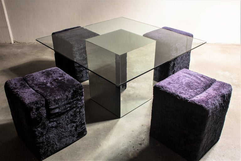 """Blok"" dining table designed by Nanda Vigo for Acerbis 1971. Square tabletop with central base consisting of a mirrored glass removable ""Block"" (attached by articulated hinges). The glass top rests on the block via a guard rail that guarantees"
