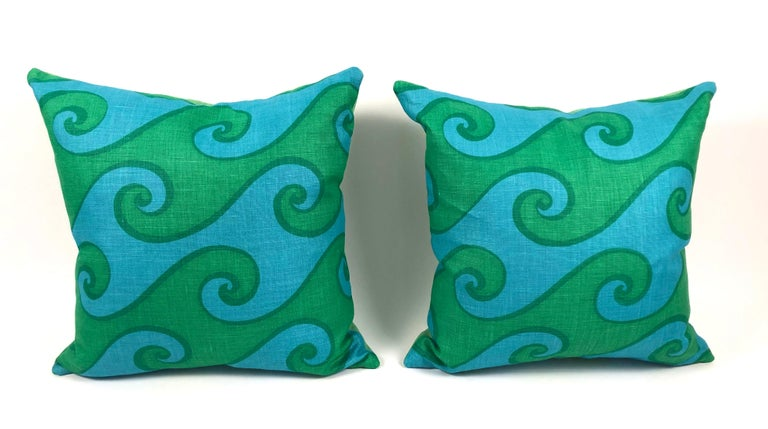 A pair of vivid blue and green wave pattern vintage hand printed linen pillows in the Sea Scroll pattern by Elenhank. 4 or more available. Sold individually. Made using original, mint condition fabric, with new down filled inserts and green linen